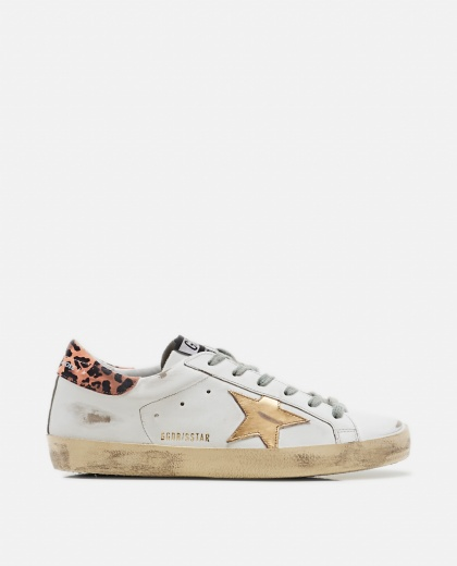 White and orange Superstar sneaker with leopard effect