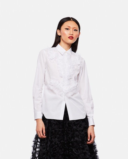 Shirt with ruffles.