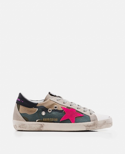 Superstar sneakers with fuchsia star and black heel.