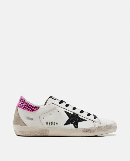 Superstar sneakers with black glitter star and pink glitter tag